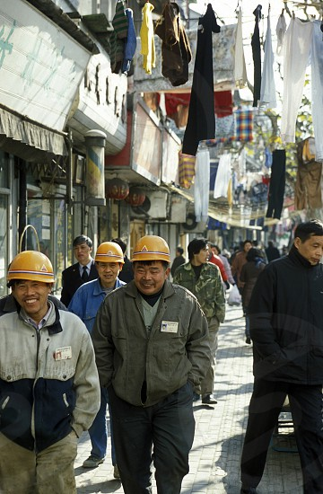 worker in the old town in the City of Shanghai in china in east asia.  photo
