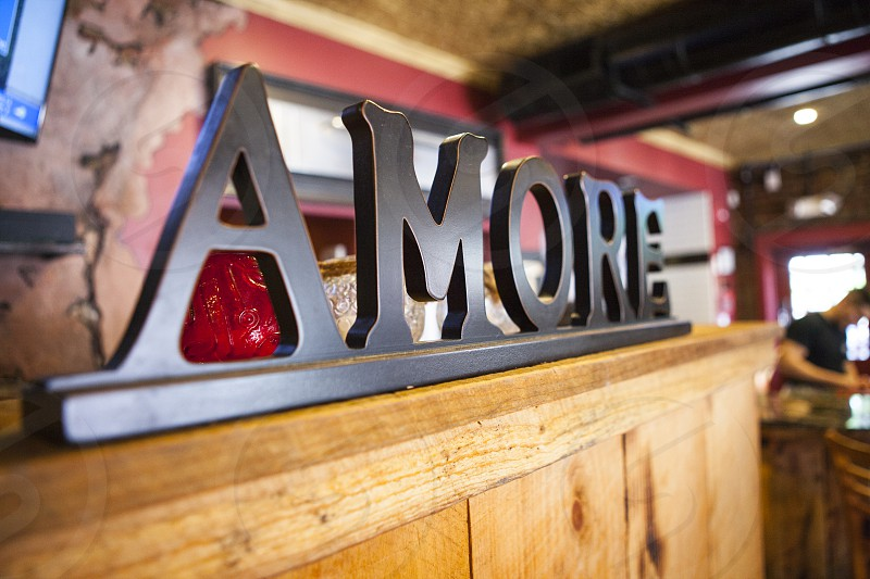 selective focus photography of black wooden amore free standing letter photo