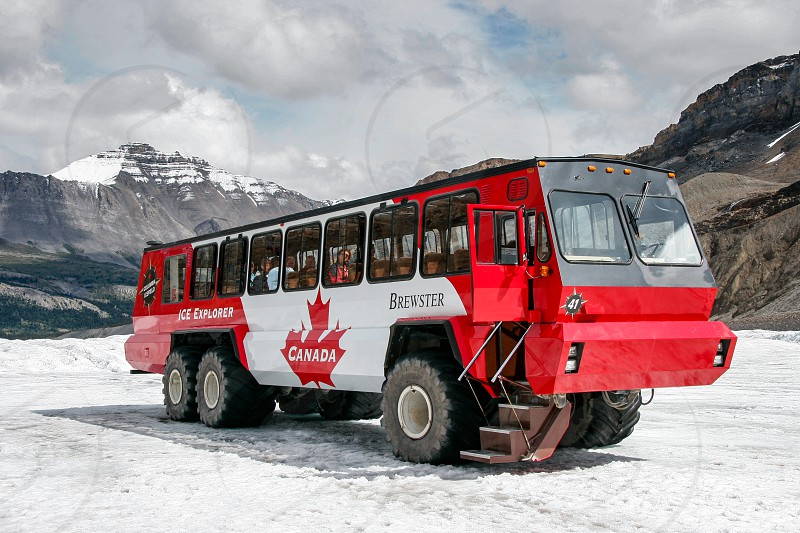 Tourist Bus on the Athabasca Glacier in Jasper National Park photo