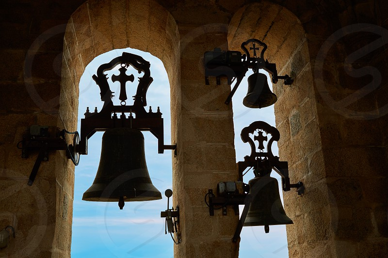 Concatedral de Santamaria Belfry bell Caceres in Extremadura at spain photo