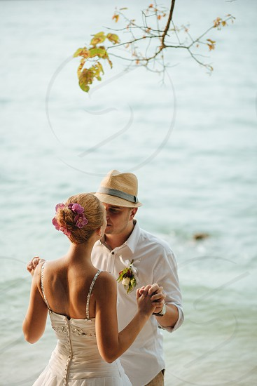 Beautiful couple standing by the sea photo