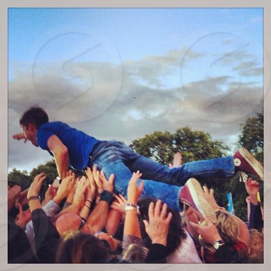 man wearing blue denim jeans photo