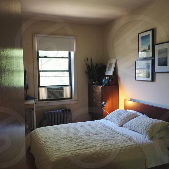 A tidy city bedroom photo