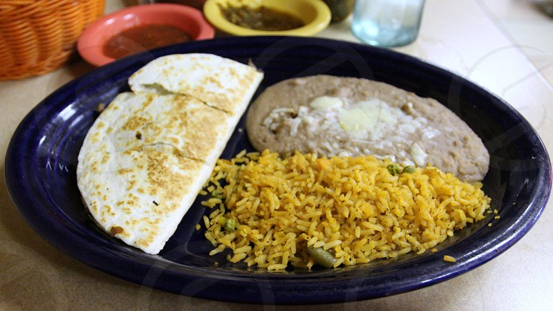 Mexican blue plate with quesadilla rice and beans salsas photo