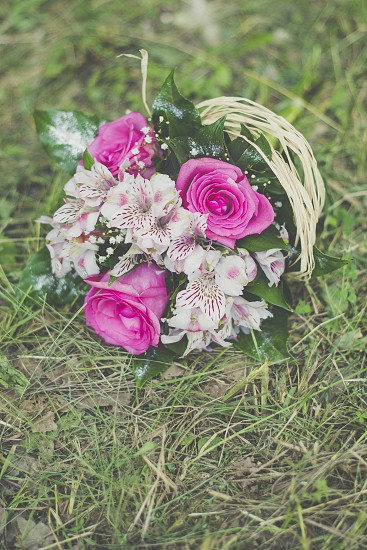 wedding bouquet lying on the grass photo