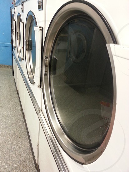 white and silver front load washing machine photo