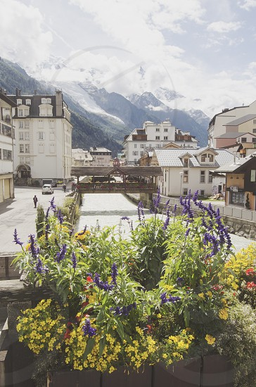 View of Arve river buildings of Chamonix and Mont Blanc Massif French Alps photo