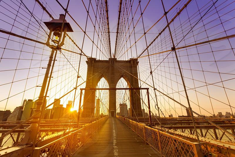 Brooklyn Bridge sunset New York Manhattan skyline NY NYC USA photo