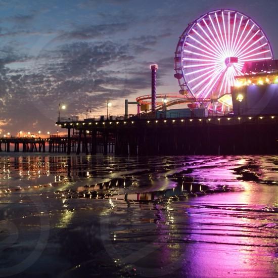 ferris wheel near sea photo