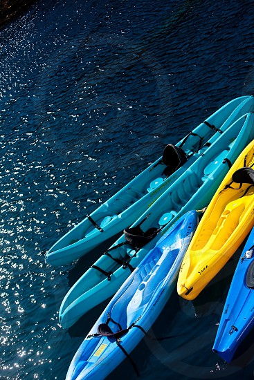 blue and yellow canoe macro photography photo