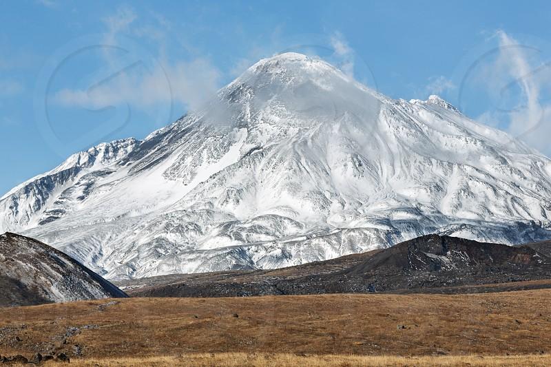 Volcanic landscape on Kamchatka Peninsula: view on active Bezymianny Volcano(Bezymiannaya Sopka). Eurasia Russian Far East Kamchatka Region Klyuchevskaya Group of Volcanoes. photo