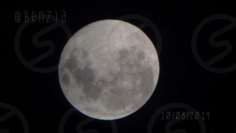 The moon through my sons Telescope photo