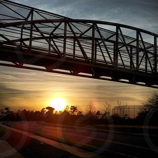 sunset bridge highway road photo