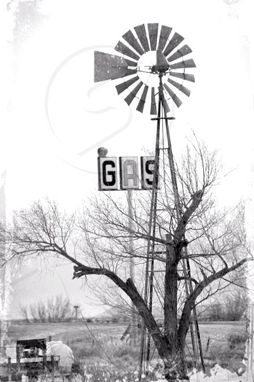 old windmill at gas station on highway photo