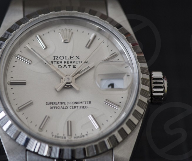 white and silver rolex analog watch photo