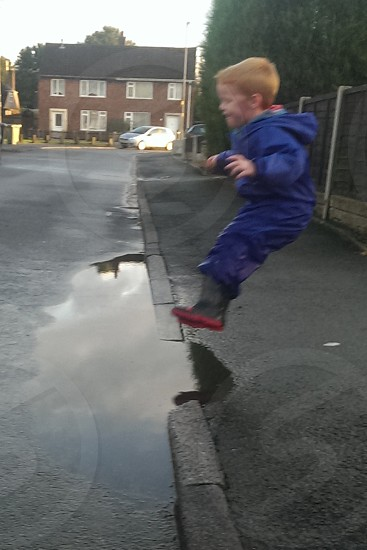 Anticipation of splashing in puddles photo