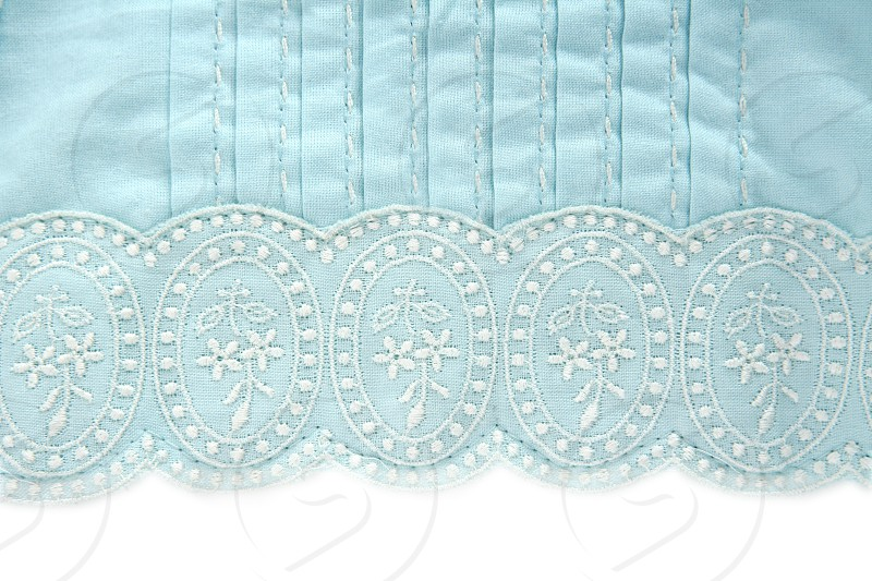 embroidery truquoise fabric white flower design pattern photo