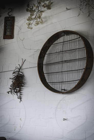 Interior wall with dried flowers and vintage feature on the wall. photo