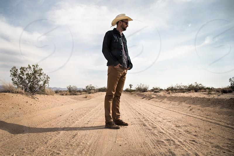 Man walks in the desert. photo