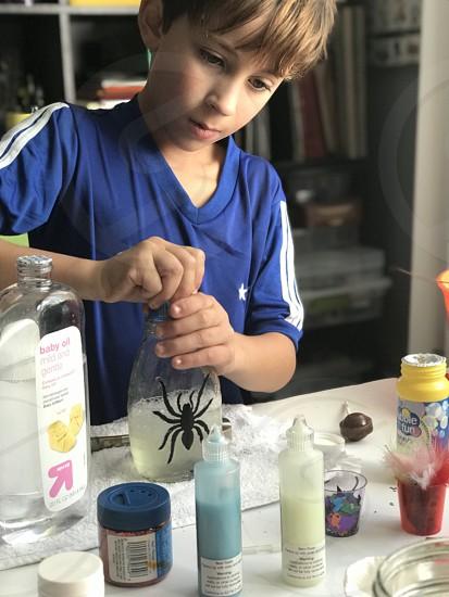 Creative kids making spider portion  photo