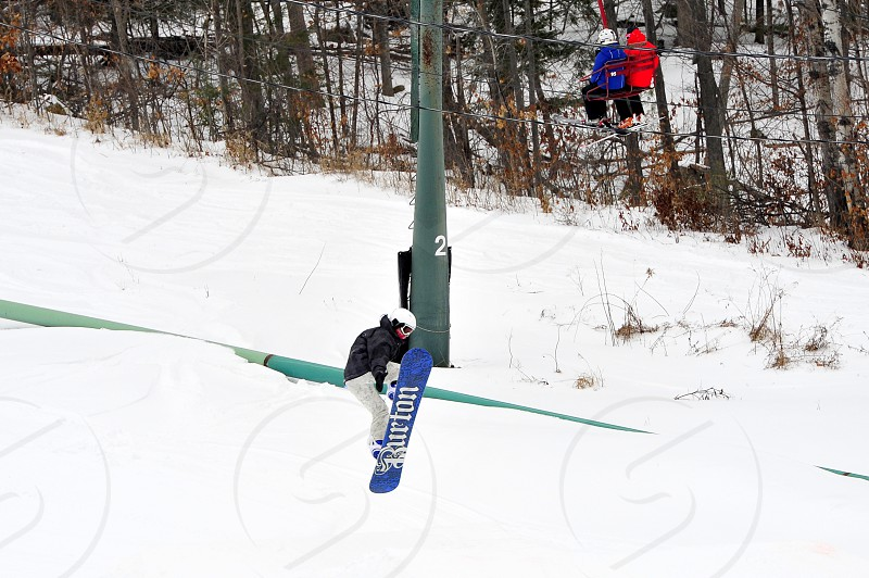 Snowboarder jumping photo