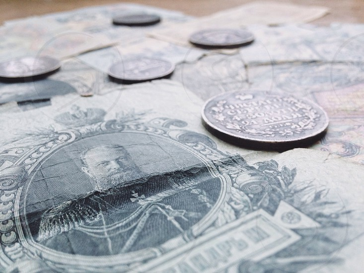silver round coins on banknote photo
