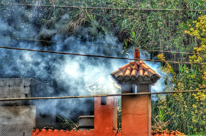 A wood burning restaurant in the Canary Islands. Smoke rising from a chimney. photo