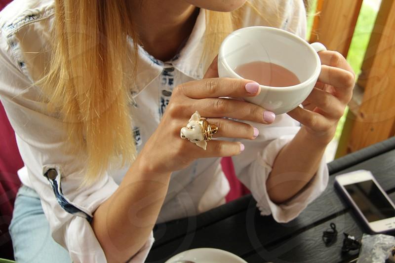 Breakfast morning good light tea cup hands enjoy hair closeup sugarfree jeans ring nail outside food eat drink hot photo