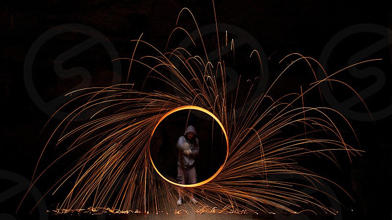 spinning fire abstract night photography long exposure action sparks fire fireworks  photo