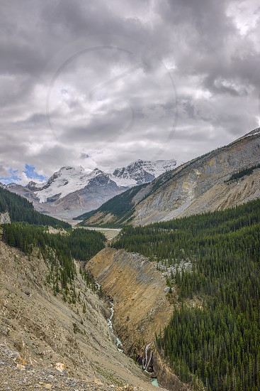 The view of the valley of Sanvapta and Mount Athabasca from Athabasca Glacier Skywalk. Jasper National Park. Alberta. Canada photo