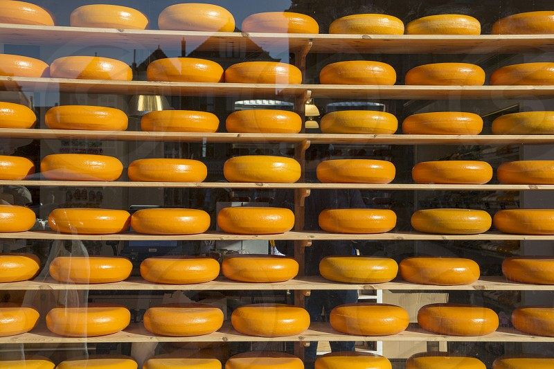 Famous Dutch cheese on the shelves in the store window photo