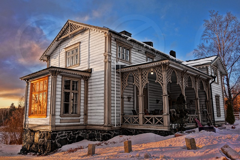 Villa of a famous Finnish painter and artist Akseli Gallen-Kallela that now functions as a cafe is one of the key attractions of Espoo Finland.  photo