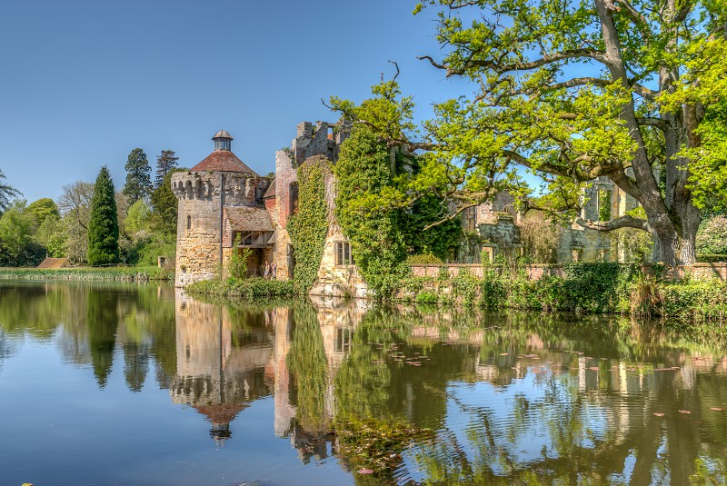 Scotney Castle with Tree and moat reflection High Dynamic Range image photo