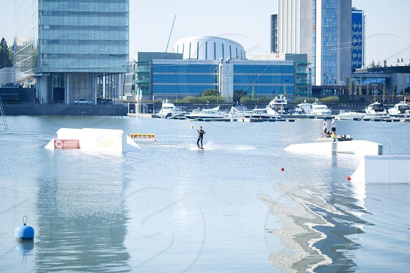 waterskiing at a lake photo