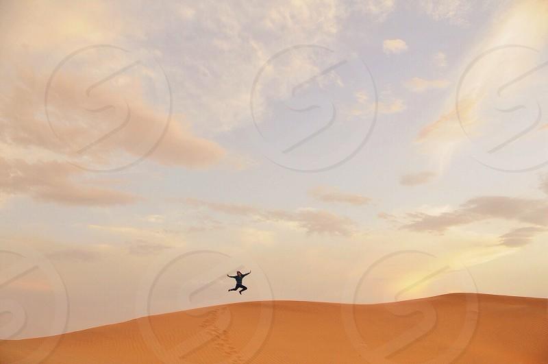 man on desert photography  photo