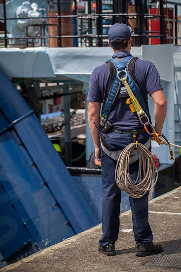 Rope worker marine deep see fishing fishing boat men at work harness Seattle  photo