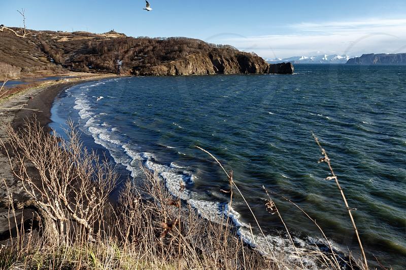 Beautiful seascape of Kamchatka Peninsula: spring view of Avachinskaya Bay or Avacha Bay (Pacific Ocean). Eurasia Russian Far East Kamchatka Region. photo