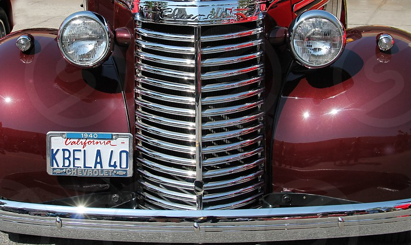 Detail of front  of a classic car with its license plate photo