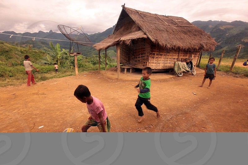 childern play soccer near the Village of Muang Phou Khoun on the Nationalroad 13 on the way from Vang Vieng to Luang Prabang in Lao in southeastasia. photo
