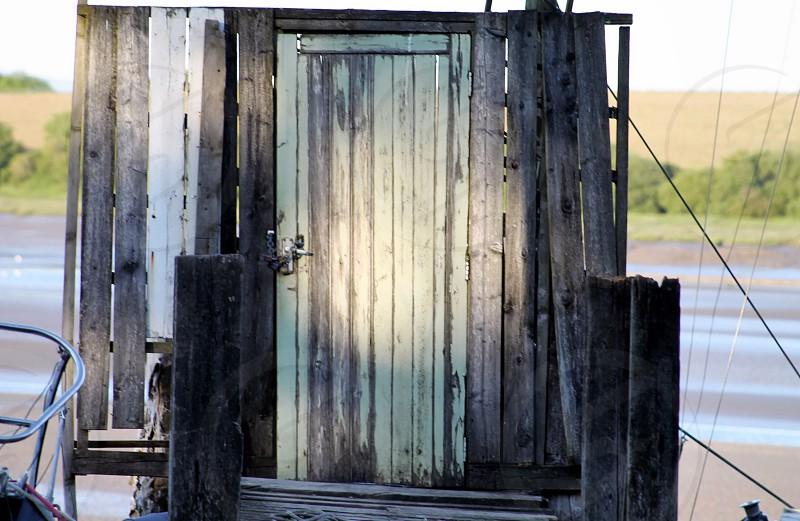 The wooden door to the sea photo