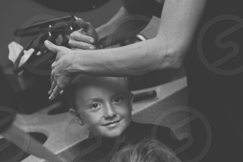 child getting hair cut at spa sink photo