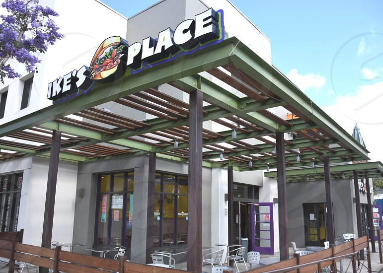 ike's place white and gray logo photo