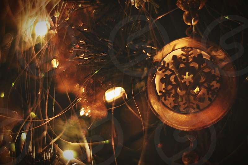 closeup photography of brown lighted bauble photo