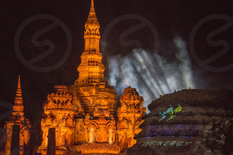 the Wat Mahathat Temple at night in the Historical Park in Sukhothai in the Provinz Sukhothai in Thailand.   Thailand Sukhothai November 2018 photo
