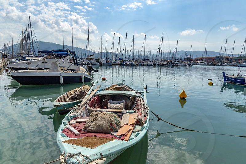 Docked sailboats in the small marina of Lefkas town Lefkada Greece photo