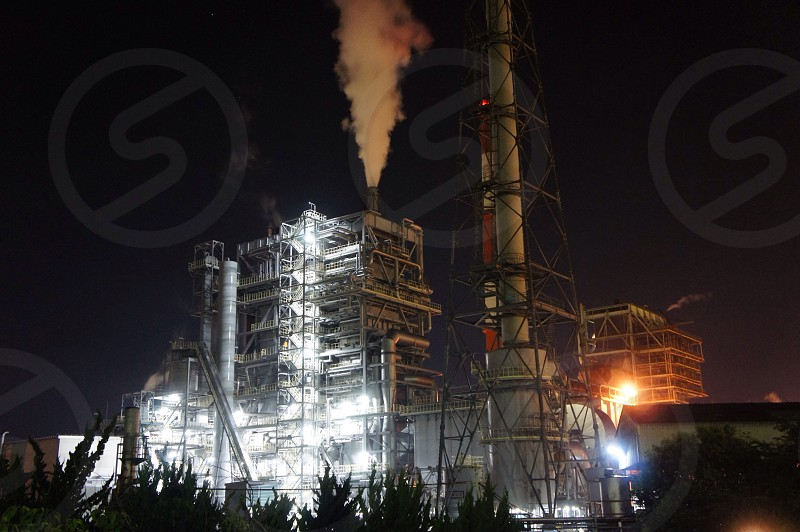 plant factory with white smoke coming out from chimney during nighttime photo