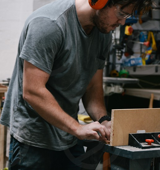 Man working hard in his woodshop photo