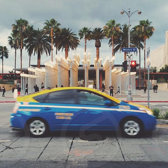blue and yellow sedan photo