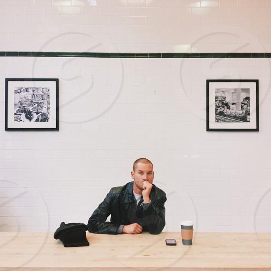 man sitting at table photo