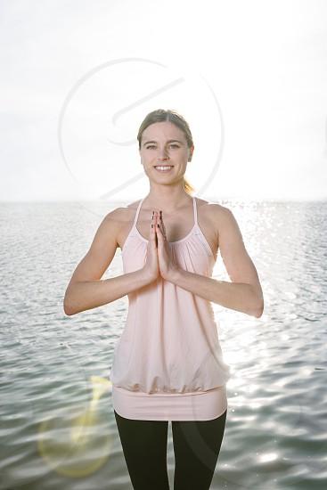 Beautiful peaceful woman outdoors near the water.  photo